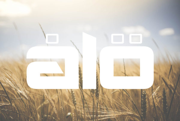 Image of Alo logo on top of an image of a field. Photo by glenn carstens peters